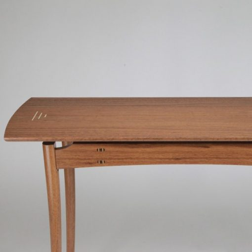 A Brolga Hall Table in jarrah with rock maple highlights
