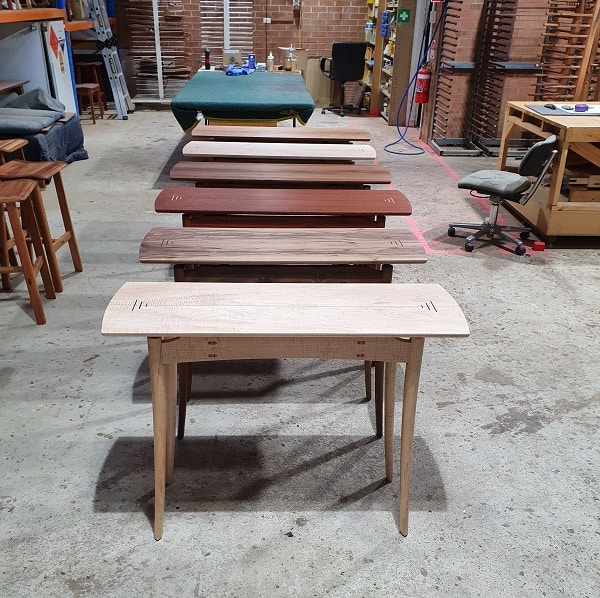 A collection of Brolga Hall Tables