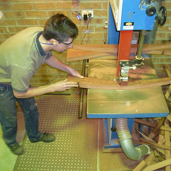 Alex MacFarlane bandsawing out Clearwater back legs