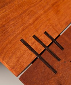 Detail of a Jindabyne Coffee Table in red gum with Wenge detailing.