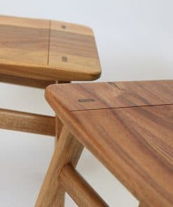 A detail of the low River Stool in blackwood