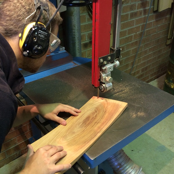 Rolf Barfoed bandsaws the back of a Sabine chair